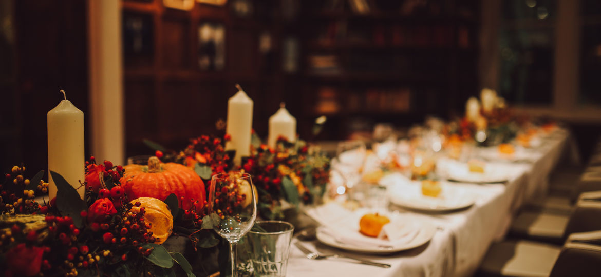 Thanksgiving table setting with automnal decorations, pumpkins,